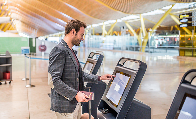 Using a self-service kiosk at Airport