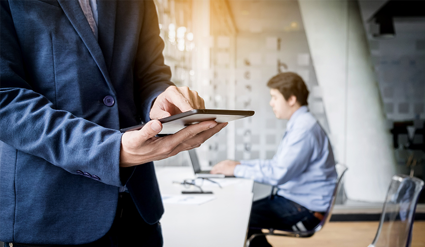 Businessman using Android tablet as a work device