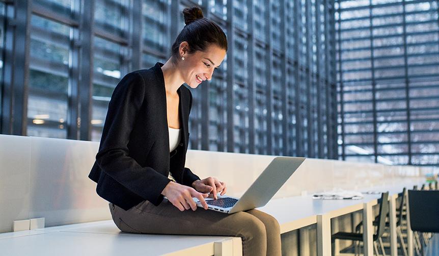 Businesswoman using a managed Mac