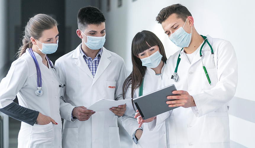 Doctors using tablet locked by Android Kiosk Software for analyzing patient data