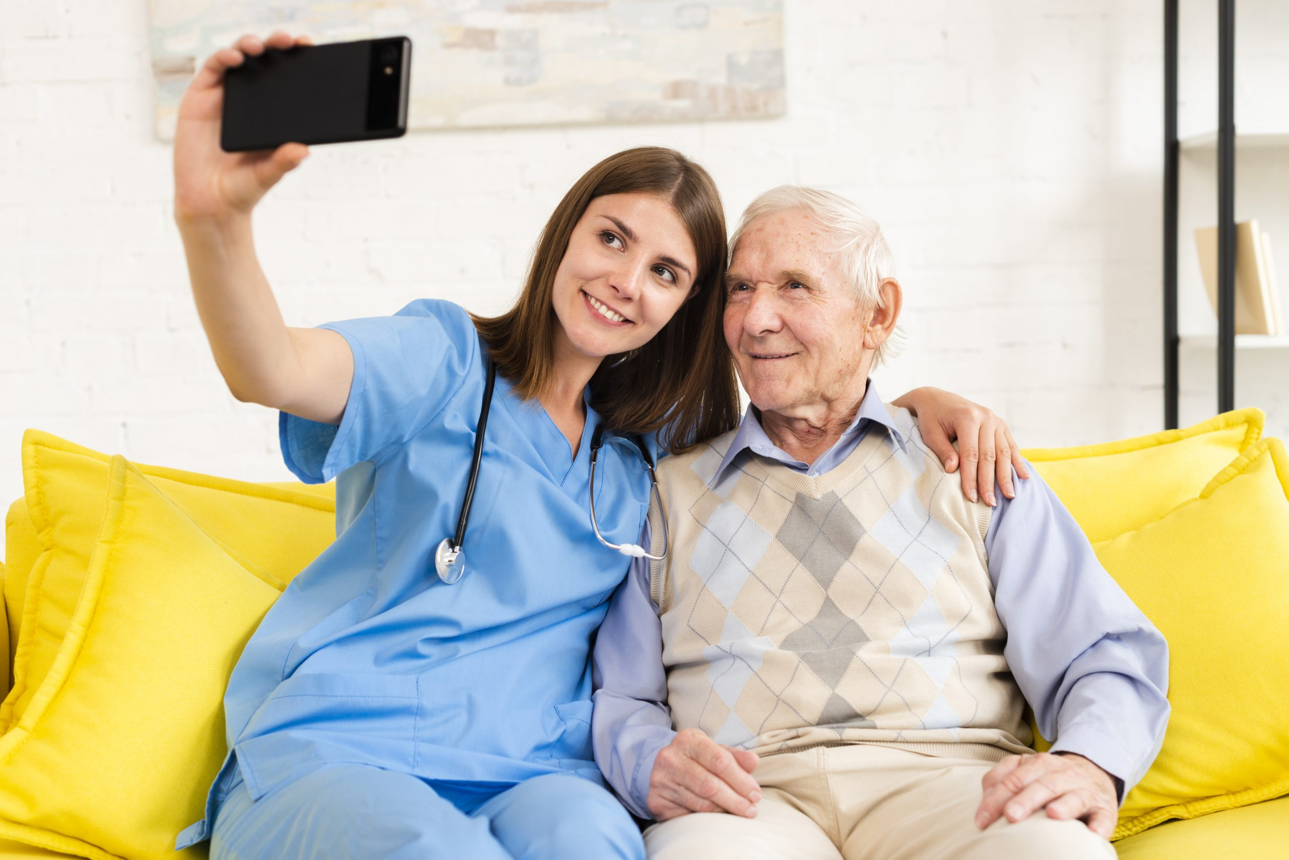Nurse taking pic with resident
